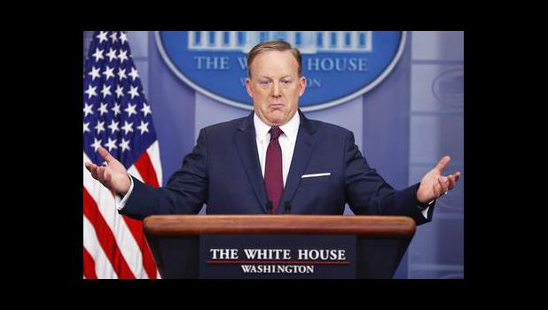 In this March 24, 2017, file photo, White House press secretary Sean Spicer gestures while speaking to the media during the daily briefing in the Brady Press Briefing Room of the White House in Washington. The AP reported on June 9, 2017, that a story claiming Spicer told reporters President Donald Trump has the power to change the way English words are spelled is a hoax. (AP Photo/Pablo Martinez Monsivais, File)