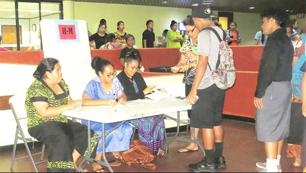 The atrium area of the EOB in Utulei was jammed packed yesterday afternoon after participants in the Summer Youth Employment Program were notified that their paychecks were ready for pick-up. [photo: Sabrina Sinapati]