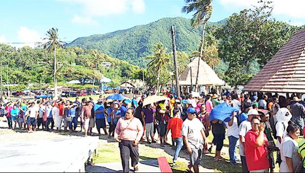 """In the sweltering heat, hundreds of employees from StarKist Samoa and Talofa Systems were at the Suigaula ole Atuvasa Beach Park this past Saturday to pick up their care packages and other items donated by """"Love Thy Neighbor"""" and other local businesses. [photo: courtesy]"""