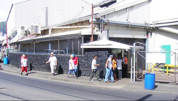 StarKist employees entering the canning plant in American Samoa.