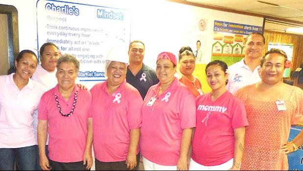 StarKist Samoa management including Taotasi Archie Soliai (far right back row) and some of the cannery's employees, wearing pink last Friday, for Breast Cancer Awareness Month of October