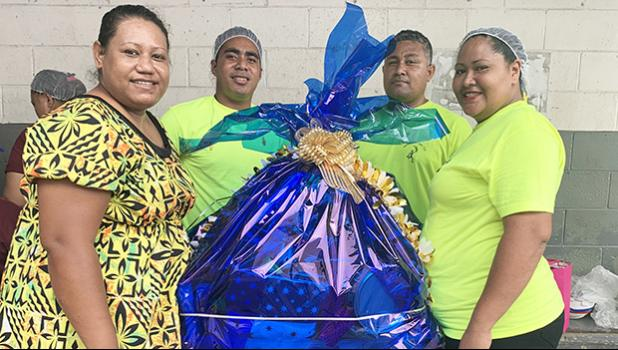 StarKist employees at the canning plant with gifts