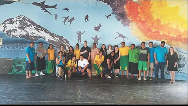 Students from Wahtonka Community School pose in front of a 38-foot-by-13-foot mural they painted in an open-air high school cafeteria in American Samoa. [courtesy photo]
