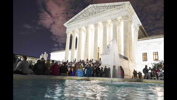 People gather at the Supreme Court Friday, Sept. 18, 2020, in