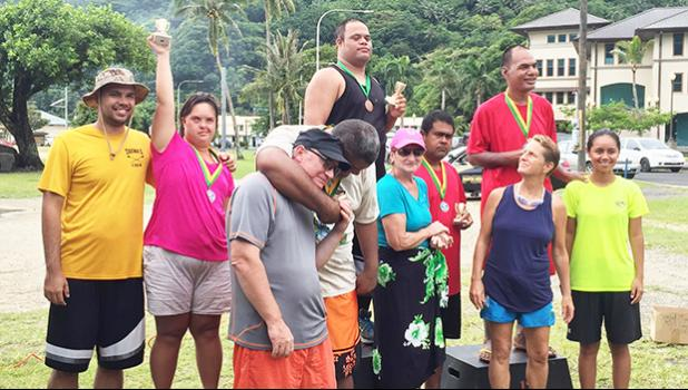 Sandy Scanlan coordinator of the PCSN with some of the athletes with special needs together with their families and friends who received gold medals during the Awards Ceremony of the first adaptive aquatic Swim Meet for special needs athletes in Amerika Samoa last Saturday at Utulei Beach. [Photo: Ese Malala]