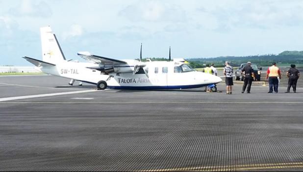 This Jan. 11, 2018 photo, circulated on social media, shows the Talofa Airways plane on its belly on the taxi-way at the main terminal at Pago Pago International Airport.  [Facebook photo]