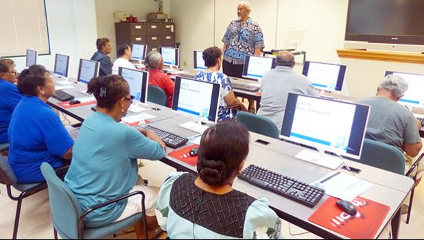 Computer instructor, Loring Fa'iivae (front-standing) of the Feleti Barstow Public Library on Tuesday during the start of the basic computer skills taught class for seniors