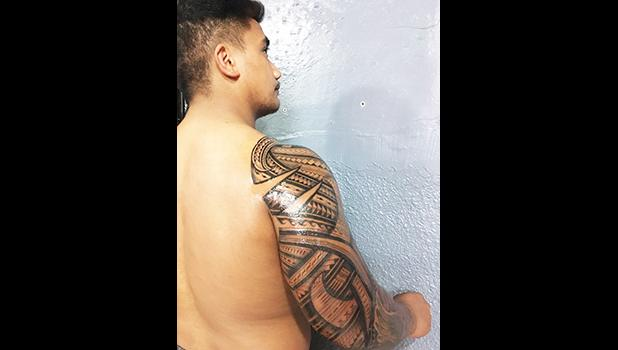 One of the 20 people, so far, who has agreed to get inked and take part in an ongoing study that could possibly prove a link between tattoos and a robust immune system. Pictured is an arm sleeve by Off Da Rock owner Joseph Ioane. See story for full details.  [photo: courtesy]