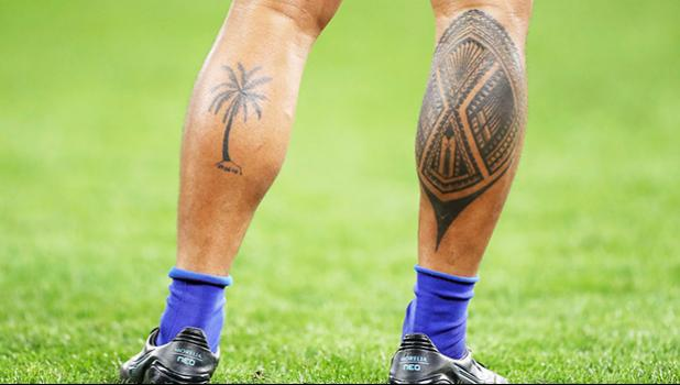 Tattoos on legs of rugby player