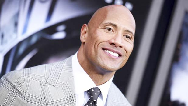 "Dwayne Johnson arrived at the May 2015 premiere of ""San Andreas"" at the TCL Chinese Theatre in Los Angeles. Johnson told GQ for a story published today that he is seriously considering a run for president. [AP file photo]"