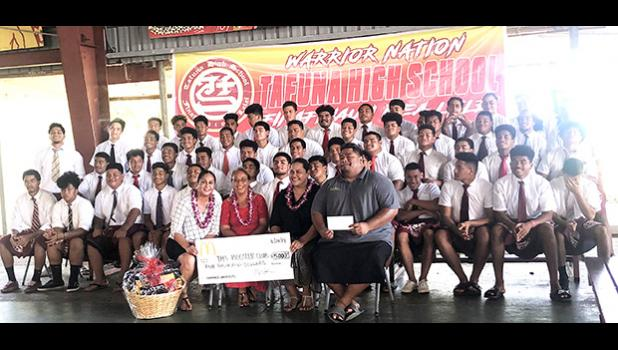 Pictured are the Warriors football players with school principal Tutuila Togilau, Head Coach  Kevin Magalei and McDonald's reps Dolores Tautolo and Katie Leilua.
