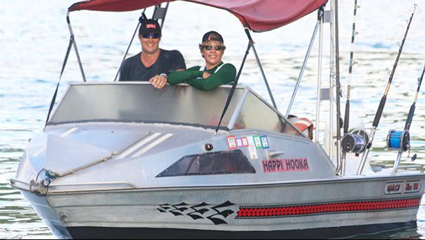 Tisa and Candyman aboard his fishing boat.