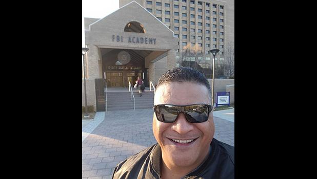 Lt. Tolia Tanu Solaita Jr. in front of FBI Academy