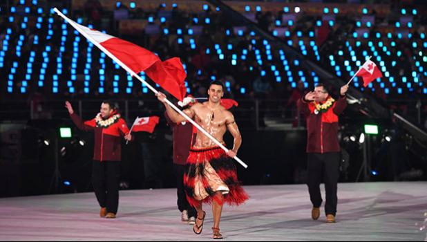 Tonga's flagbearer Pita Taufatofua leads his country's delegation. [Photo: AFP via RNZI]