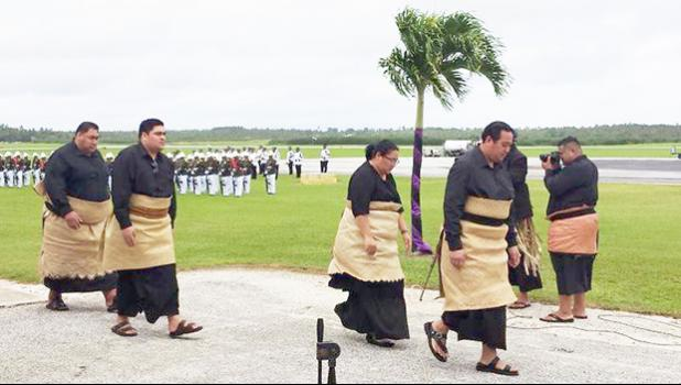 Tonga's Crown Prince Tupouto'a 'Ulukalala, (right), leads members of the royal family to welcome the body of Queen Mother Mata'aho home [Photo: Sia Adams / RNZI]
