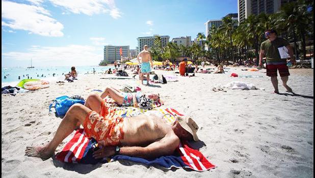 Tourists on Waikiki Beach