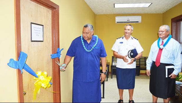 Lt. Gov. Lemanu Peleti Mauga (far left) cuts the ribbon to officially open yesterday morning the Transnational Crime Network center in American Samoa that is overseen by the Department of Public Safety. Looking on are Samoa Police Commissioner Fuiavailiili Egon Keil (middle) and American Samoa Police Commissioner Le'i Sonny Thompson (far right). [photo: AF]