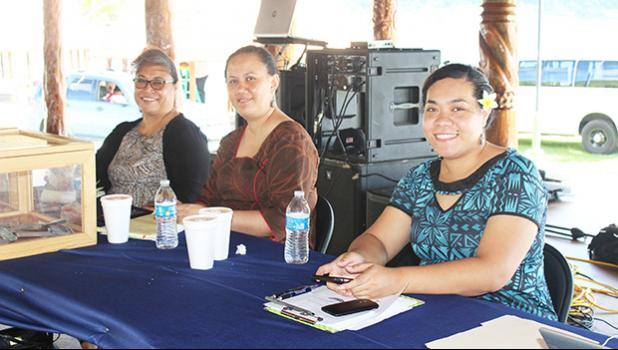 A trio of ASG personnel posing for a Samoa News photo at first day of fundraising