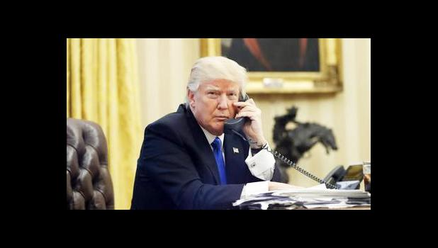 In this Jan. 28, 2017, file photo, U.S. President Donald Trump speaks on the phone with Prime Minister of Australia Malcolm Turnbull in the Oval Office of the White House in Washington. For decades, Australia and the U.S. have enjoyed the coziest of relationships, collaborating on everything from military and intelligence to diplomacy and trade. Yet an irritable tweet President Donald Trump fired off about Australia and a dramatic report of an angry phone call between the nations' leaders proves that the ne