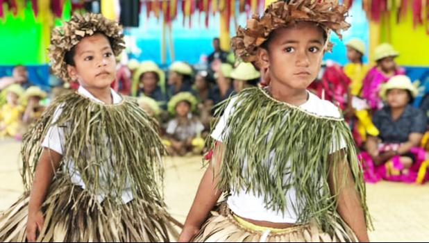 Tuvaluan children sing a welcome for Pacific leaders at Funafuti airport.