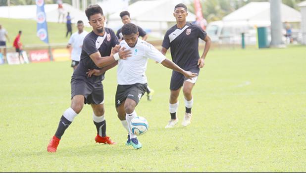 Ueli Tualaulelei (left) of American Samoa defends