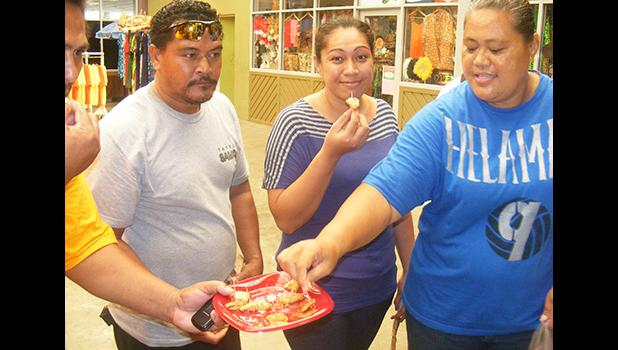 Some of the local residents as they taste samples of the gluten free breadfruit pancakes during a demonstration last Friday at the Fagatogo Market Place by Rep. Su'a Alexander Eli Jennings.  [photo: FS]