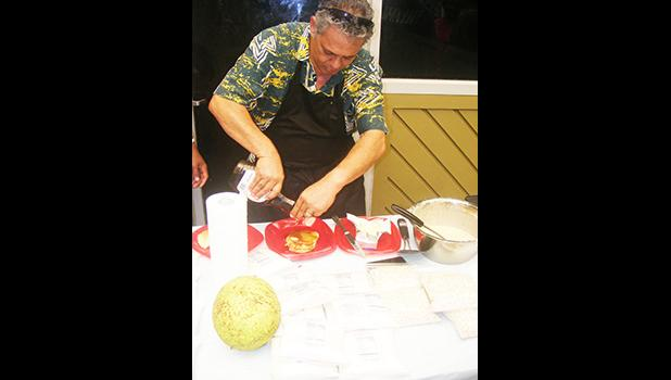 Rep. Su'a Alexander Eli Jennings pours syrup on gluten free breadfruit pancakes during a demonstration last Friday at the Fagatogo market place. [photo: FS]