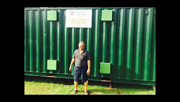 Su'a Alexander Eli Jennings outside of the retrofitted freight container back in October 2015 where raw ulu is processed and dried to be milled into gluten free, low glycemic index flour. The container operates on solar panels to provide renewable energy for the retrofitted container.   [SN file photo]