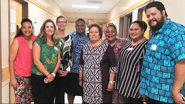 Jessica Podoski (second from left) and the American Samoa climate change working group pausing for a photo with American Samoa's Congresswoman Aumua Amata (center)
