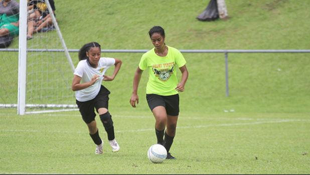A Pago Youth defender, right, dribbles the ball out of danger against Utulei Youth
