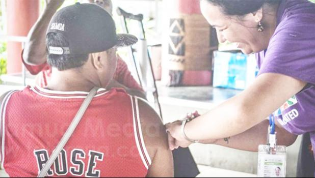 Man getting COVID-19 vaccine