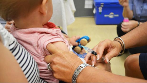 photo of a child being vaccinated