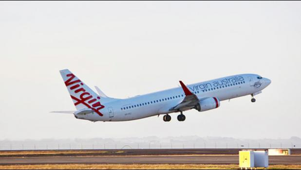 A Virgin Australia Boeing 737 takes off at Auckland Airport. [Photo / Grant Bradley via NZ Herald]