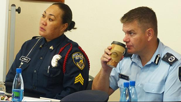 DPS Detective Vaivasa Wells (left), pictured with Matthew Varley