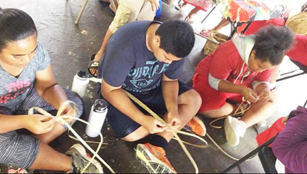 Weaving is one of the activities for the kids involved in the 2017 summer FIT program. Earlier this month, the group took a field trip to the TAOA center where they learned how to create items using dried leaves. [Courtesy photo]
