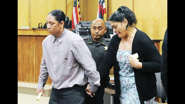 Lama Lauvao and Natisha Tautalatasi are led out of the courtroom after the jury delivered its verdict Tuesday