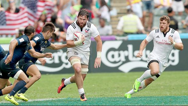 At the HSBC World Rugby Sevens Series XVIII in Hong Kong on April 8, 2017 USA's Danny Barrett makes a break with Stephen Tomasin in support.  USA beat Argentina 33-5 to win Pool D with 9 points.   USA will face England in the Cup quarter finals.  Argentina  will play Australia, winner of Pool A.