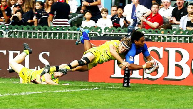 Gordon Langkilde scores in the corner in Hong Kong against Australia.  Australia, the top seed in pool A, narrowly beat Samoa 22-19.  Samoa now faces England and Korea on Saturday in their other two pool play matches at the 2017 Cathay Pacific/HSBC Hong Kong Sevens.