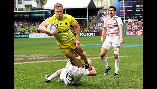 At the HSBC World Rugby Sevens Series XVIII in Hong Kong on April 8, 2017 Australia's Henry Hutchinson goes airborne against England to score Australia's first try.  Argentina beat England 12-10 to win Pool A.  Australia will play Argentina in the Cup quarter final.  England will play against USA.