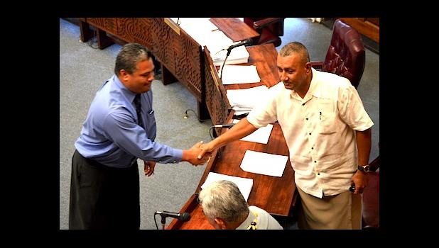 Chief of Customs, Keith Gebauer (left) shaking hands with Faimealelei A. F. Allen