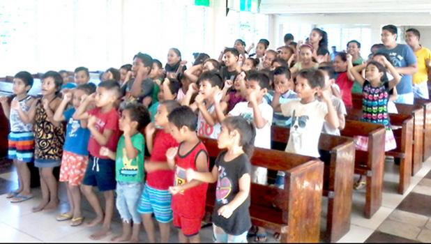 Vaimoso Methodist Church children learning their White Sunday verses.