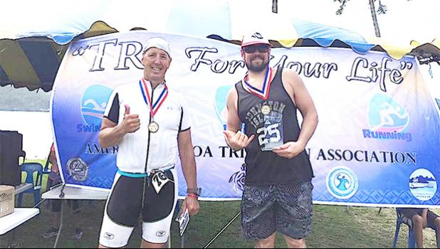 Winners of Saturday's Triathlon Olympic Division: Scott Alpuerto (first place) and Matt Bracken (2nd place). The Olympic challenge featured a mile swim, twenty-four-mile bike route, and a six-mile run. See story for full details.  [photo Mark Espiritu]