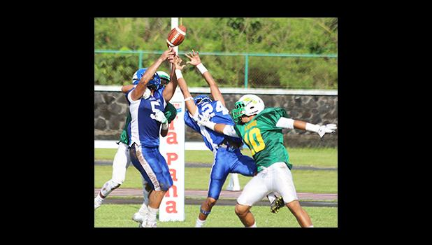 Samoana Sharks safety Cornelius Aiava (5) tries to intercept a pass from Lions quarterback Ma'ae, intended for Ali'itoa Langkilde in the first half of their varsity match up this past Saturday. Leone Lions won 28– 7 against the Samoana Sharks.  [photo: TG]