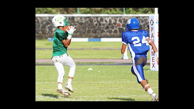 Ali'itoa Langkilde of Leone catching his first touchdown pass of the game – he led the Lions with two touchdowns that pulled Leone to their third victory of the season. [photo: TG]