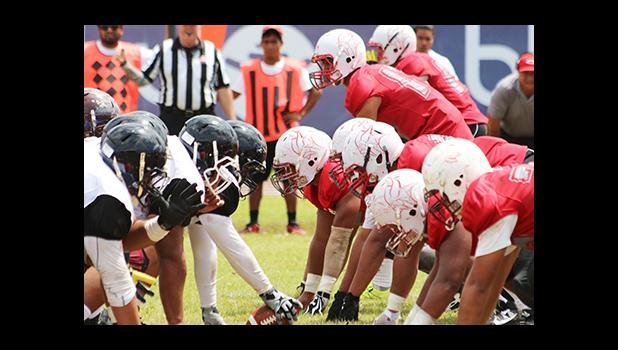Warriors and Vikings at the line of scrimmage during their Battle of the Toa's rivalry match up last Saturday, which Tafuna won 28- 16. [photo: TG]