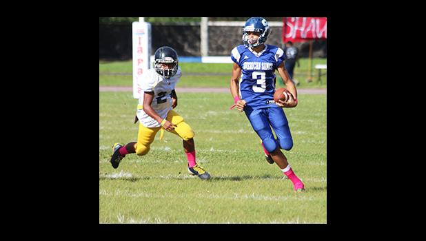 Player of the Game JV Jurgen Krusen, of Samoana High School storming towards the sidelines to take this one to the end zone – Krusen scored three touchdowns for Samoana in their 36 - 20 win over the Wildcats last Saturday. [photo: TG]