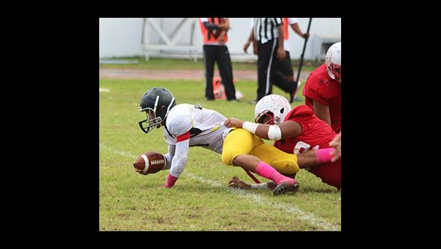 Iosefa Mauga of Nu'uuli gets tackled short of the first down marker in the second half of their JV match against the Vikings last Saturday, as the second game of the triple header for ASHSAA Football Week No. 9. [photo: TG]