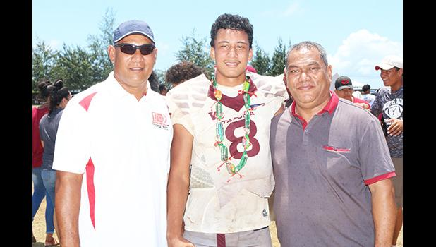 The 'Sophomore' quarterback for the Warriors, Francisco Mauigoa (8) posing with his father Fa'alialia Mauigoa (left) and his uncle