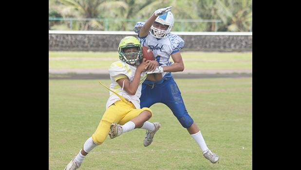 A Leone Lions receiver tries to gain control of the ball while defending was Prodieus Lutu-Fuga of the Sharks
