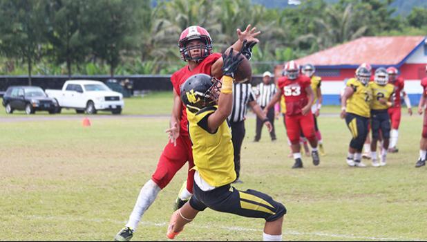 PJ Tufugafale securing a catch against Faga'itua's Tevita Tevita